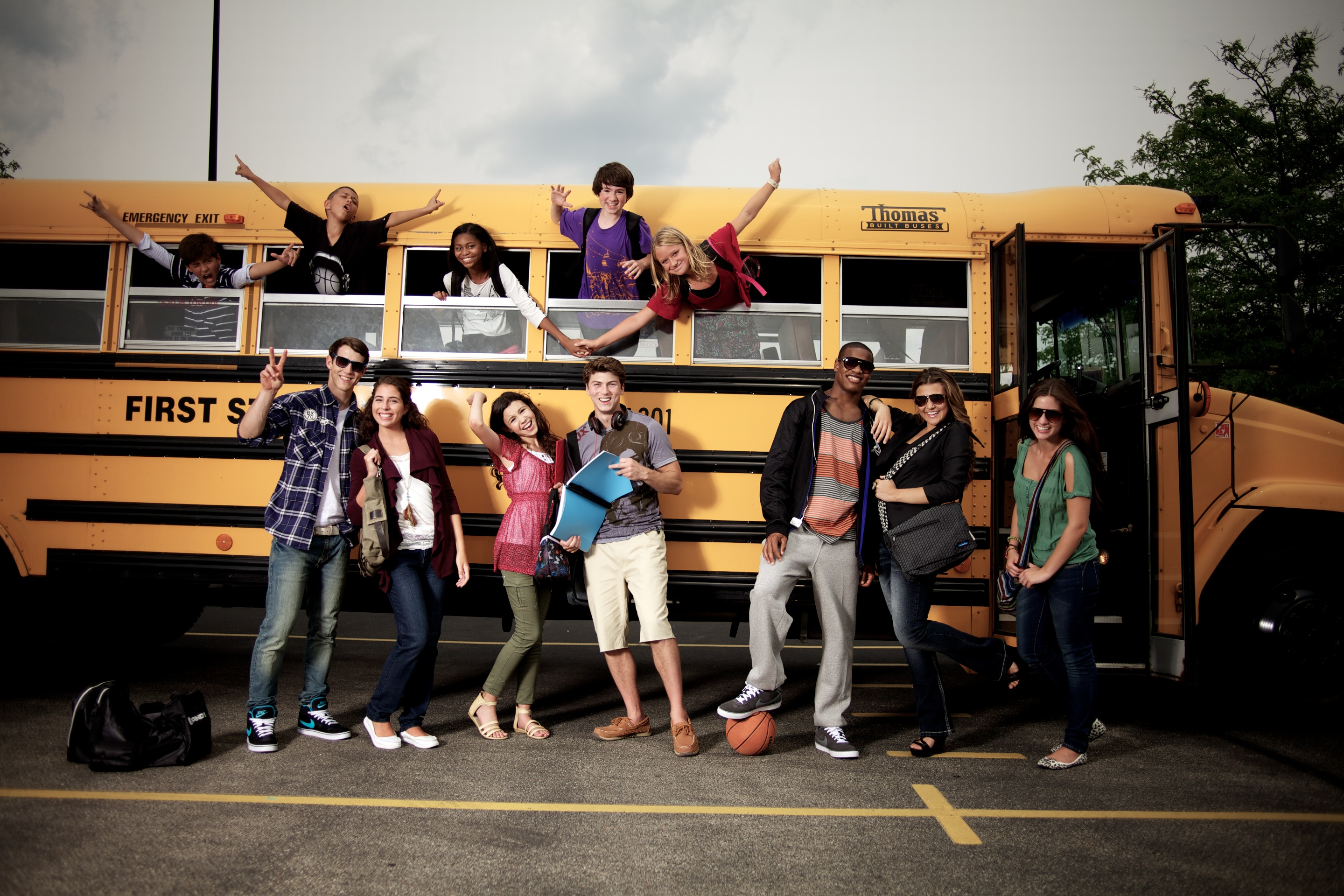 photograph of students with a school bus, back to school retail fashion photography by travis neely